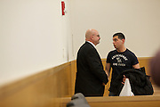 BROOKLYN, NY-- Gerard Honig, boyfriend of victim Yelena Bulchenko, speaks with Ken Taub after Maksim Gelman, 24, was sentenced in Brooklyn Supreme Court on the afternoon of Wednesday, January 18, 2012.  Gelman pled guilty to attempted murder in connection with his attack on a subway passenger on February 12, 2011.  <br /> <br /> CREDIT: Andrew Hinderaker for the Wall Street Journal