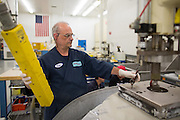 Tom Worden works on a fixed-abrasive grinding table at Exelis Inc. in Rochester, New York on September 10, 2014. Exelis is an aerospace and defense company, and employs numerous former Kodak workers in its Rochester facility.