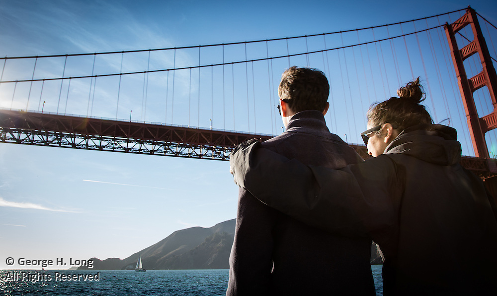 Trey Dye and Emma Chammah sail under Golden Gate Bridge in San Francisco Bay