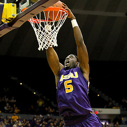 November 12, 2011; Baton Rouge, LA; LSU Tigers forward Malcolm White (5) dunks against the Nicholls State Colonels during the second half of a game at the Pete Maravich Assembly Center. LSU defeated Nicholls State 96-74.  Mandatory Credit: Derick E. Hingle-US PRESSWIRE
