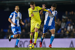 January 7, 2018 - Vila-Real, Castellon, Spain - Raba (C) of Villarreal CF competes for the ball with Juanfran of Deportivo de La Coruna during the La Liga game between Villarreal CF and Deportivo La Coruna at Estadio de la Ceramica on January 7, 2018 in Vila-real, Spain  (Credit Image: © David Aliaga/NurPhoto via ZUMA Press)