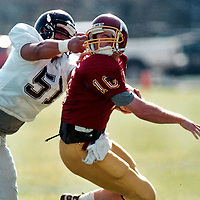 -<br /> <br /> -Southern Oregon's John Avalos takes down Willamette quarterback Chuck Pinkerton by the facemask in Saturday's game.