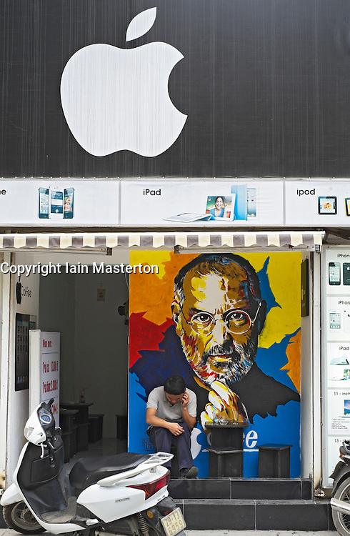 Small Apple computer shop with portrait of Steve Jobs in Hanoi Vietnam