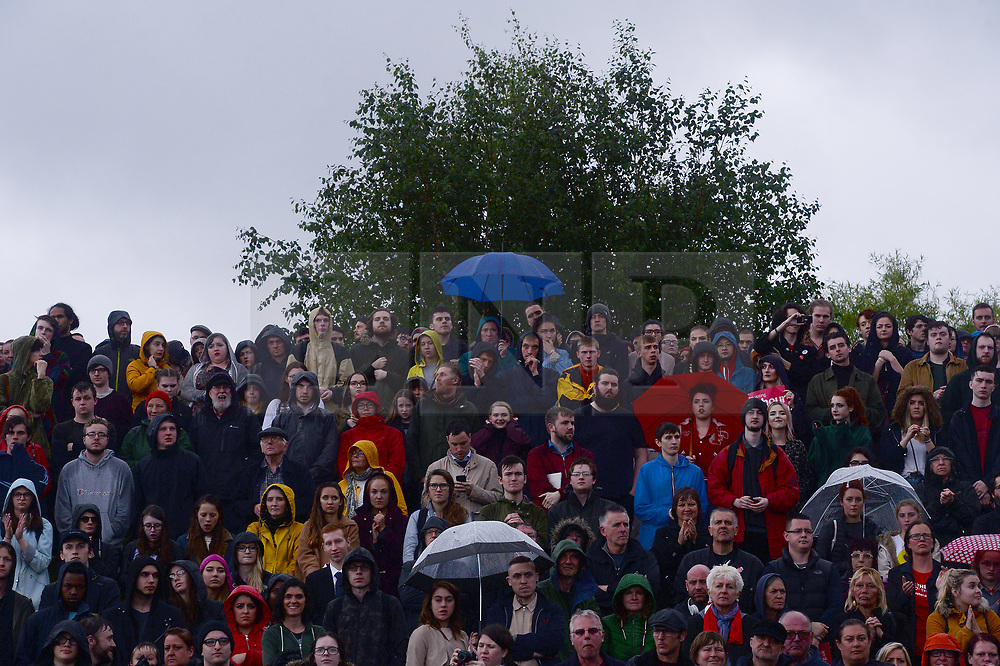 © Licensed to London News Pictures. 05/06/2017. Newcastle Upon Tyne, UK.  A crowd of all ages waits to hear from Jeremy Corbyn MP, Leader of the Labour Party, as he addresses hundreds of his supporters who waited in the rain to hear him speak outside the Sage in Gateshead. Mr Corbyn spent one of the final days of the campaign trail in the Labour heartlands of North-East England before voters go to the polls in the UK General Election on June 8th 2017. Photo credit: MARY TURNER/LNP