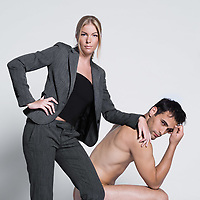 young couple with man naked in studio on isolated grey background
