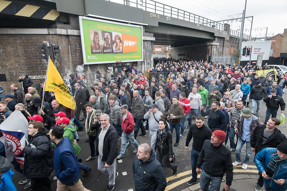 © Licensed to London News Pictures . 24/03/2018. Birmingham, UK. FLA supporters march to Birmingham City Centre at a Football Lads Alliance demonstration against Islam and extremism . Offshoot group, The True Democratic Football Lads Alliance, also hold a separate demonstration . Photo credit: Joel Goodman/LNP