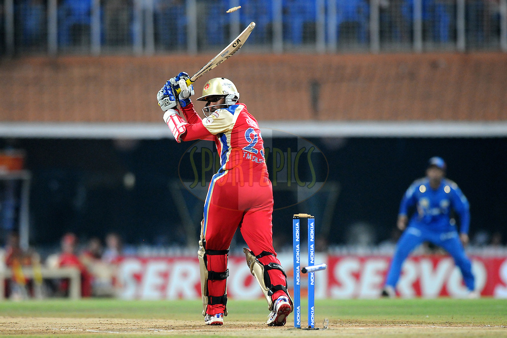 Tilakaratne Dilshan of Royal Challengers Bangalore gets bowled out during the Final of the NOKIA Champions League T20 ( CLT20 ) between The Royal Challengers Bangalore and The Mumbai Indians held at the M. A. Chidambaram Stadium in Chennai , Tamil Nadu, India on the 9th October 2011..Photo by Pal Pillai/BCCI/SPORTZPICS