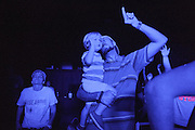 TRUSSVILLE, AL - AUGUST 27, 2013: Mason Rule (right) worships with his nephew during a service at The Basement, a Christian youth ministry widely known for its club atmosphere and large crowds. The worship gathering, held at the B-Studio in Trussville, was the first meeting since The Basement's founder Matt Pitt was arrested for impersonating a police officer on August 20, 2013. CREDIT: Bob Miller for The New York Times.