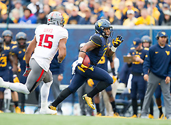 Nov 7, 2015; Morgantown, WV, USA;  West Virginia Mountaineers running back Rushel Shell runs the ball during the first quarter against the Texas Tech Red Raiders at Milan Puskar Stadium. Mandatory Credit: Ben Queen-USA TODAY Sports