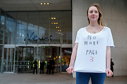 "© Licensed to London News Pictures. 25/01/2015. LONDON, UK. ""No More Page 3"" campaigners protesting against The Sun's decision to bring the 'Page 3' back after a week, outside News UK HQ in central London on Sunday, 25 January 2015. Photo credit : Tolga Akmen/LNP"