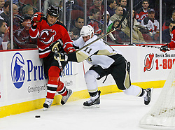 Dec 10, 2008; Newark, NJ, USA; Pittsburgh Penguins center Jordan Staal (11) hits New Jersey Devils center Bobby Holik (16) during the second period at the Prudential Center.