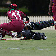 Lucy Doolan collides with West Indian wicket keeper Merissa Aguilleira after she is run out during the West Indies V New Zealand group A match at Bankstown Oval  in the ICC Women's World Cup Cricket Tournament, in Sydney, Australia on March 10, 2009. New Zealand won by 56 runs. Photo Tim Clayton