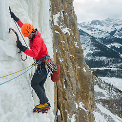 Kris Irwin Leading the Ice Climb Amadeus in Kananaskis, WI4 - M5