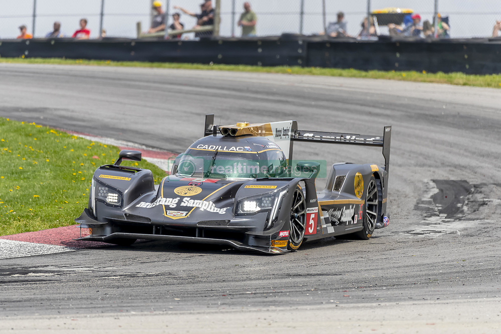 May 6, 2018 - Lexington, Ohio, United States of America - The Mustang Sampling Racing Cadillac DPI car races through the keyhole turn during the the Acura Sports Car Challenge at Mid Ohio Sports Car Course in Lexington, Ohio. (Credit Image: © Walter G Arce Sr Asp Inc/ASP via ZUMA Wire)