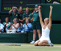 WIMBLEDON CHAMPIONSHIPS 03/07/04 DAY 12<br />MARIA SHARAPOVA (RUS) SINKS TO HER KNEES AS SHE WINS  LADIES FINAL<br />Photo Roger Parker Fotosports International