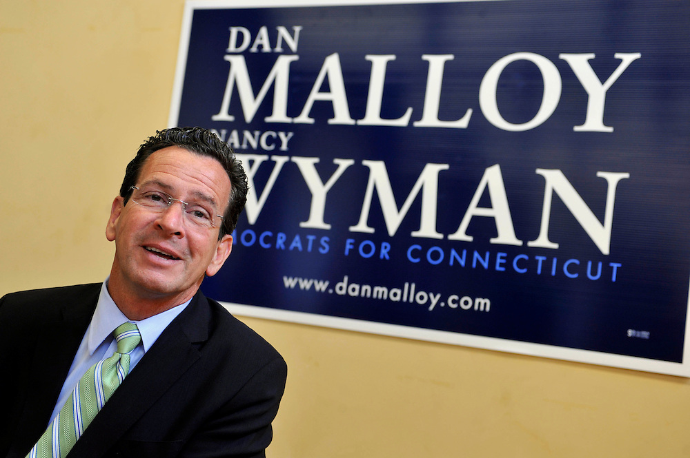 Democratic candidate for governor Dan Malloy holds a news conference at his headquarters after winning yesterday's primary over Ned Lamont in Hartford, Conn., Wed. Aug. 11, 2010.   (AP Photo/Jessica Hill)