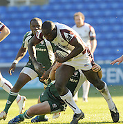 Reading, GREAT BRITAIN, Tigers, Ayoola ERINLE, shakes off Shane GERAGTY's tackle,as he starts his run for the line, during the Guinness Premiership match, London Irish vs Leicester Tigers, played at the Madejski Stadium, on Sun. 17th Feb 2008.  [Mandatory Credit, Peter Spurrier/Intersport-images].....Watford, GREAT BRITAIN, during the Pool 4 Rd 5  Heineken Cup game Saracens vs Biarittz at Vicarage Road, Hert's  26/04/2007  [Photo, Peter Spurrier/Intersport-images].....