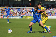 AFC Wimbledon defender George Francomb (7) holding off Bristol Rovers defender Jake Clarke-Salter (36) during the EFL Sky Bet League 1 match between AFC Wimbledon and Bristol Rovers at the Cherry Red Records Stadium, Kingston, England on 8 April 2017. Photo by Matthew Redman.