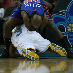 New Orleans Hornets guard Chris Paul #3 struggles to hold on as New York Knicks guard Mardy Collins #25 reaches in for the ball during the first half of their NBA game  on April 4, 2008 at the New Orleans Arena in New Orleans, Louisiana. New Orleans Hornets defeated the New York Knicks 118-110 and with the win clinched a NBA Playoff birth.