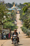 02 MARCH 2014 - MYAWADDY, KAYIN, MYANMAR (BURMA):  A family rides their motorcycle in Myawaddy, Myanmar. Myawaddy is separated from the Thai border town of Mae Sot by the Moei River. Myawaddy is the most important trading point between Myanmar (Burma) and Thailand.   PHOTO BY JACK KURTZ
