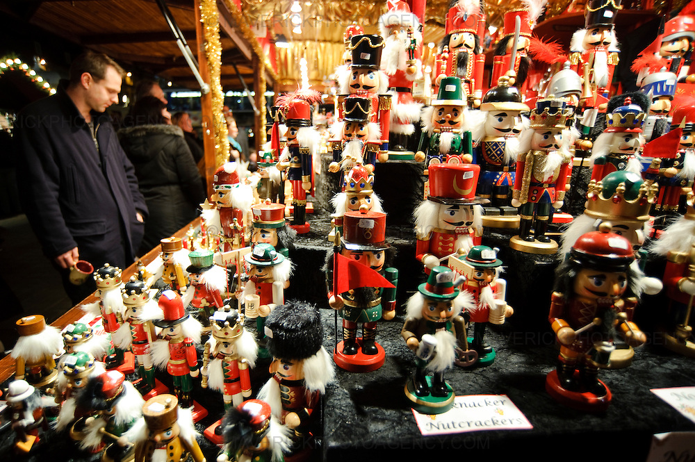 With only a few days to go before Christmas, shoppers look for last minute presents in Edinburgh's City Centre, Edinburgh, Scotland, UK.  Pictured wooden toys for sale in the German Market at Princes Street Gardens.