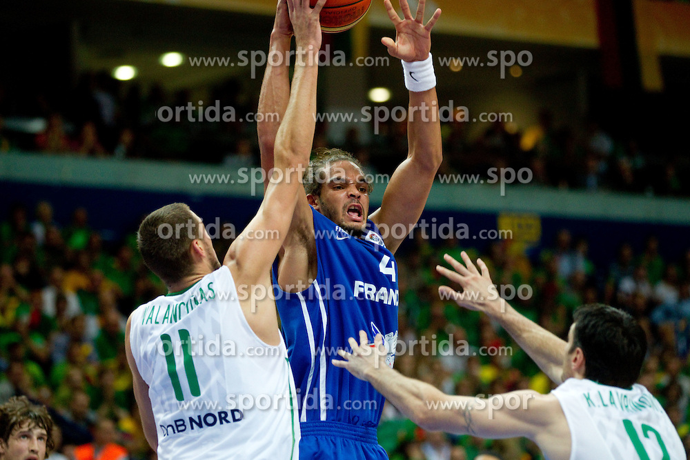 Jonas Valanciunas of Lithuania vs Joakim Noah of France during basketball game between National basketball teams of Lithuania and France at FIBA Europe Eurobasket Lithuania 2011, on September 9, 2011, in Siemens Arena,  Vilnius, Lithuania.  (Photo by Vid Ponikvar / Sportida)