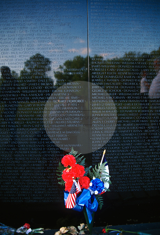A bunch of flowers rests in memory at the Vietnam Veterans Memorial wall November 11, 1996 in Washington, DC.