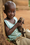 "Cedric, 4, and his pet ""mangouste"" in Man, Cote d'Ivoire on Wednesday July 24, 2013."