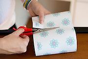 Aaron Leigh Johnson-Horton, founder of The Mesh Warrior, prepares gifts to mail to women with complications from a mesh implant at her home in Dallas, Texas on July 8, 2014. (Cooper Neill for The Texas Tribune)