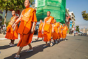 "04 FEBRUARY 2013 - PHNOM PENH, CAMBODIA: Cambodian Buddhist monks walk to the cremation venue for the cremation of King-Father Norodom Sihanouk in Phnom Penh. Norodom Sihanouk (31 October 1922 - 15 October 2012) was the King of Cambodia from 1941 to 1955 and again from 1993 to 2004. He was the effective ruler of Cambodia from 1953 to 1970. After his second abdication in 2004, he was given the honorific of ""The King-Father of Cambodia."" Sihanouk died in Beijing, China, where he was receiving medical care, on Oct. 15, 2012.    PHOTO BY JACK KURTZ"