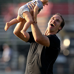 August 6, 2011; Metairie, LA, USA; New Orleans Saints quarterback Drew Brees (9) plays with his son Bowen Brees following training camp practice at the New Orleans Saints practice facility. Mandatory Credit: Derick E. Hingle