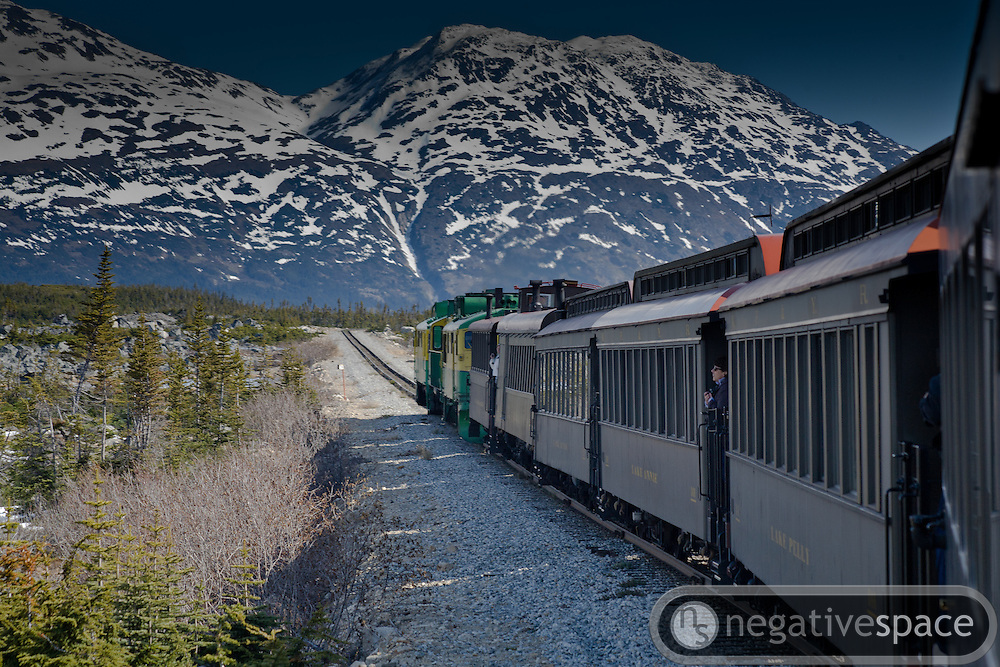 Locomotive and train of the White Pass and Yukon Railway entering the Yukon, Skagway, Alaska