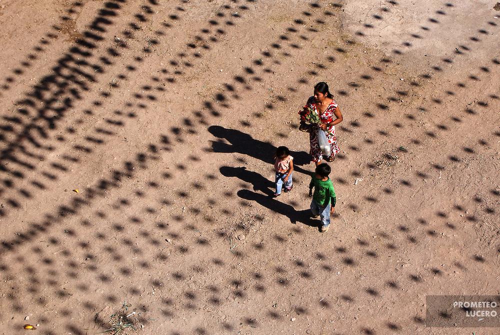 """A family walks near a church in Tlapa, Guerrero waiting for the arrival of the """"Carrera Guadalupana"""" on December 12th, 2008. / Una familia camina cerca de la iglesia durante la espera de la """"Carrera Guadalupana"""", el 12 de diciembre de 2008. (Photo: Prometeo Lucero)"""
