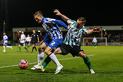 Neil Austin of Hartlepool United is challenged by Daniel Hawkins of Blyth Spartans - Photo mandatory by-line: Rogan Thomson/JMP - 07966 386802 - 05/12/2014 - SPORT - FOOTBALL - Hartlepool, England - Victoria Park - Hartlepool United v Blyth Spartans - FA Cup Second Round Proper.