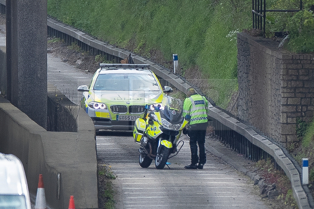 © Licensed to London News Pictures. 07/05/2019. Headley, UK. Police are seen on the M25 carriageway after a body was found earlier. A lane was closed during the investigation causing tailbacks. Photo credit: Peter Macdiarmid/LNP