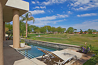 View of lawn from swimming pool in luxury mansion