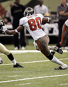 NEW ORLEANS - OCTOBER 10:  Wide receiver Michael Clayton #80 of the Tampa Bay Buccaneers on a catch and run against the New Orleans Saints at the Louisiana Superdome on October 10, 2004 in New Orleans, Louisiana. Clayton caught 4 passes for 61 yards and rushed twice for 24 yards as the Bucs defeated the Saints 20-17. ©Paul Anthony Spinelli *** Local Caption *** Michael Clayton