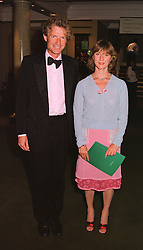 The HON.ERSKINE & MRS GUINNESS at a dinner in London on 19th May 1998.MHS 40
