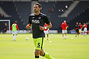 Exeter City defender Aaron Martin (5) warming up before the EFL Sky Bet League 2 match between Milton Keynes Dons and Exeter City at stadium:mk, Milton Keynes, England on 25 August 2018.