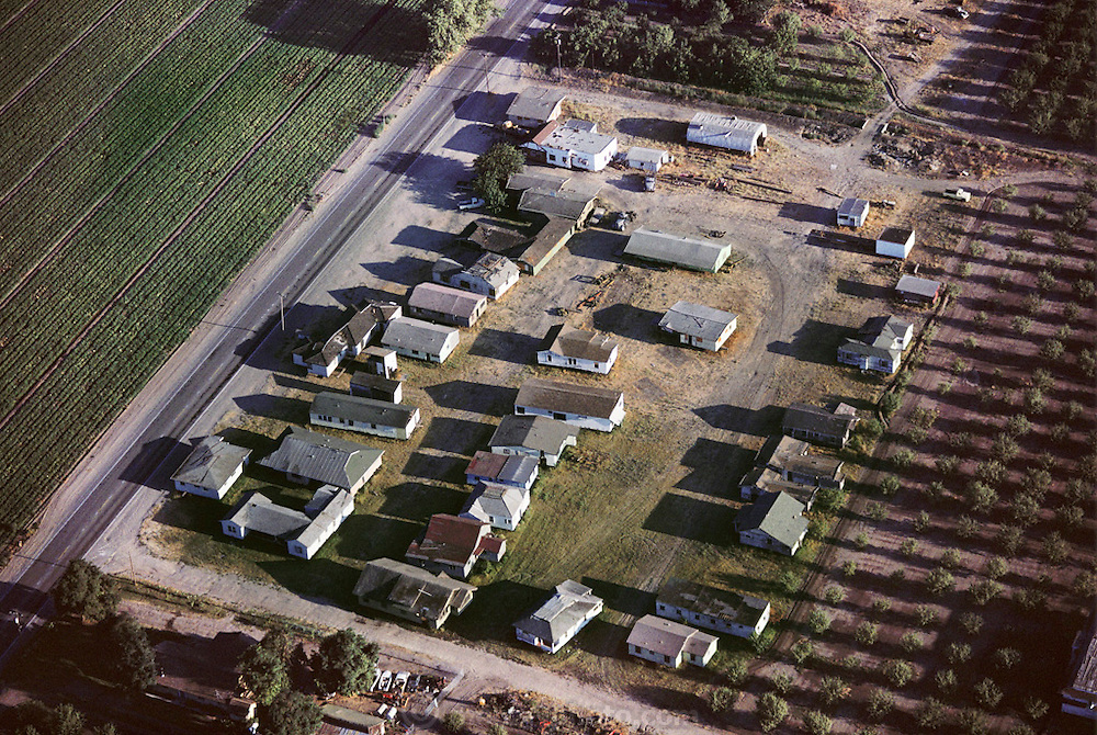 USA_HOUS_1_xs.Aerial of used house lot in Stockton, California. Old houses are moved from smaller farms and land that is being commercially developed, and put up for sale, like used cars. USA.