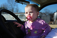 Baby Priscilla Presley in her dad's pick up.<br />