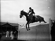 "03/08/1960<br /> 08/03/1960<br /> 03 August 1960<br /> R.D.S Horse Show Dublin (Wednesday).<br /> Mrs Dawn Wofford of Great Britain clearing a 6'4' wall in the fifth round of the Epreuve de Puissance Competition, on ""Hollandia"" owned by Mr. Warren Wofford and bred in the U.S.A.. After five clear rounds, Mrs Wofford was placed joint first with Captain W.A. Ringrose."