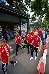 PARIS, FRANCE - Saturday, June 25, 2016: Wales' Hal Robson-Kanu, Neil Taylor and James Collins during a pre-match walk outside the Mövenpick Hotel Paris Neuilly ahead of the Round of 16 UEFA Euro 2016 Championship match against Northern Ireland. (Pic by David Rawcliffe/Propaganda)