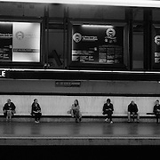 Commuters sit politely spaced as they wait for a train on the platform at Charles de Gaulle Etoile Metro station in Paris, France,  October 11, 2007. Photo Tim Clayton..Paris is often known as 'The City of Love' but like any major City in the world, the inhabitants often live a singular existence, going about their daily lives in relative solitude. Parisians are respectful of each others space, often courteous and polite while extremely conscious of their own image. While love can be seen openly around the streets of Paris, so can the separate lives of Parisians...