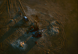 Stock photo of an aerial view of a  oil and gas rig on South Padre,Texas beach.