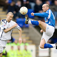 St Johnstone v Dundee....28.02.09<br /> Paul Sheerin goes in a little high on Eddie Malone<br /> Picture by Graeme Hart.<br /> Copyright Perthshire Picture Agency<br /> Tel: 01738 623350  Mobile: 07990 594431