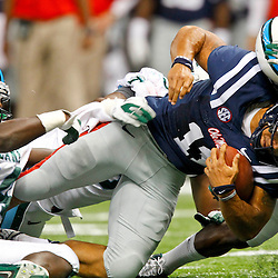 September 22, 2012; New Orleans, LA, USA; Ole Miss Rebels quarterback Barry Brunetti (11) is tackled by Tulane Green Wave linebacker Darryl Farley (34) and Tulane Green Wave safety Kyle Davis (21) during the second half of a game at the Mercedes-Benz Superdome. Ole Miss defeated Tulane 39-0. Mandatory Credit: Derick E. Hingle-US PRESSWIRE
