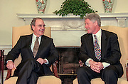 US President Bill Clinton meets with former senator and Special Envoy for Northern Ireland Peace Envoy George Mitchell at the White House April 13, 1998 in Washington, DC. Mitchell, who chaired the peace talks in Northern Ireland, praised Clinton for his help in negotiating the agreement reached April 10th in Belfast.