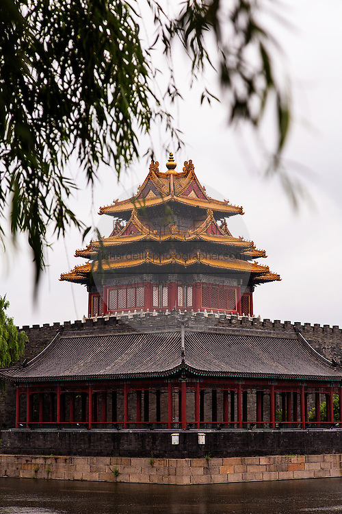 The Arrow Tower on the palace walls of the Forbidden City during a rainy summer day in Beijing, China