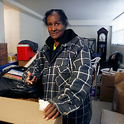 Long time Cabrini Green resident Annie Ricks and her family pack up their belongings in their apartment. The Ricks' were the last residents in the public housing building. Ricks moved on Thursday December 9, 2010.<br /> Photography by Jose More